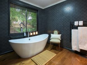 Bathroom with bath chair and garden view