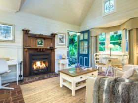 Comfort, fire in living room at Twilight Cottage