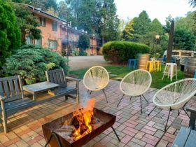 Mid century motel with outdoor firepit