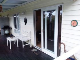 Entrance and deck space with BBQ oven