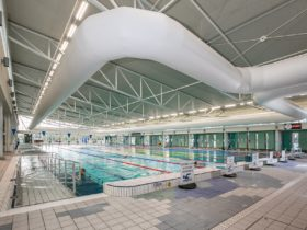 50m empty pool indoors with white ceiling above