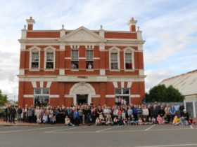 250 Dimboola locals assemble in front of the former National Bank of Australasia building.