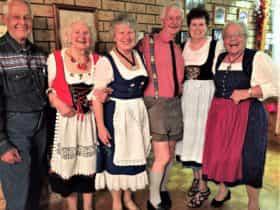 Members enjoy wearing national dress