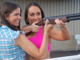 A Go Shooting instructor providing assistance to a participant.