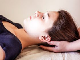 young woman receiveing a Reiki Treatment