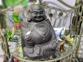 Smiling Buddah and other statues