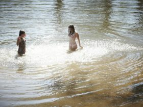 Swimming at the Ovens River North beach