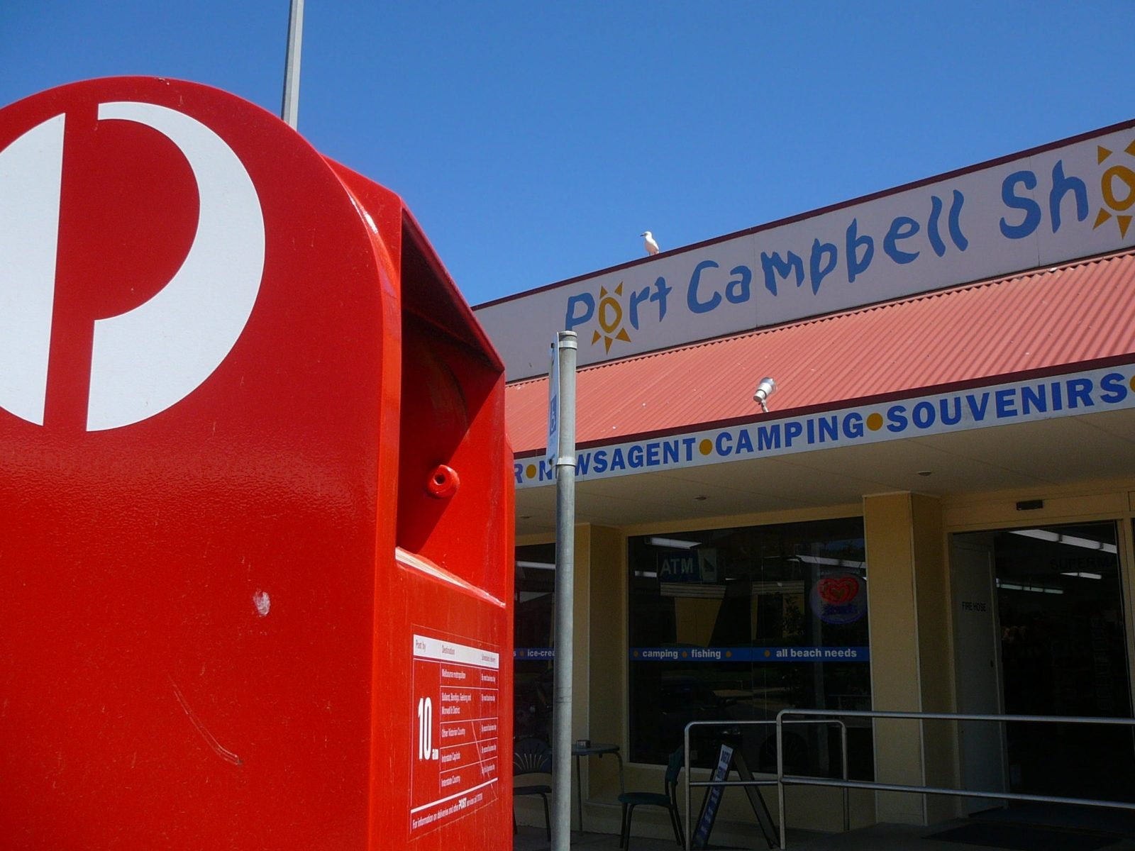 Main entrance to the store, showing close up of Australia Post post box