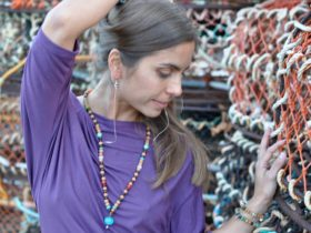 Model is wearing SilknSilver asymmetrical t-shirt, Mala necklace and sapphire chain earrings.