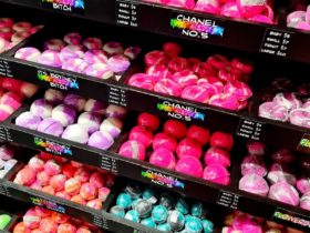 Black tiered shelves of bright pink, purple and blue bath bombs on display