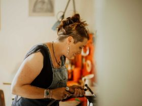 Image of jeweller Rachel Grose working on a new work.