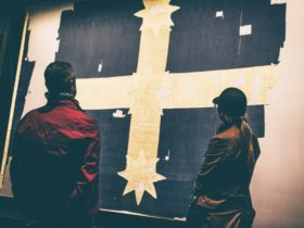 Two adults viewing the Eureka Flag