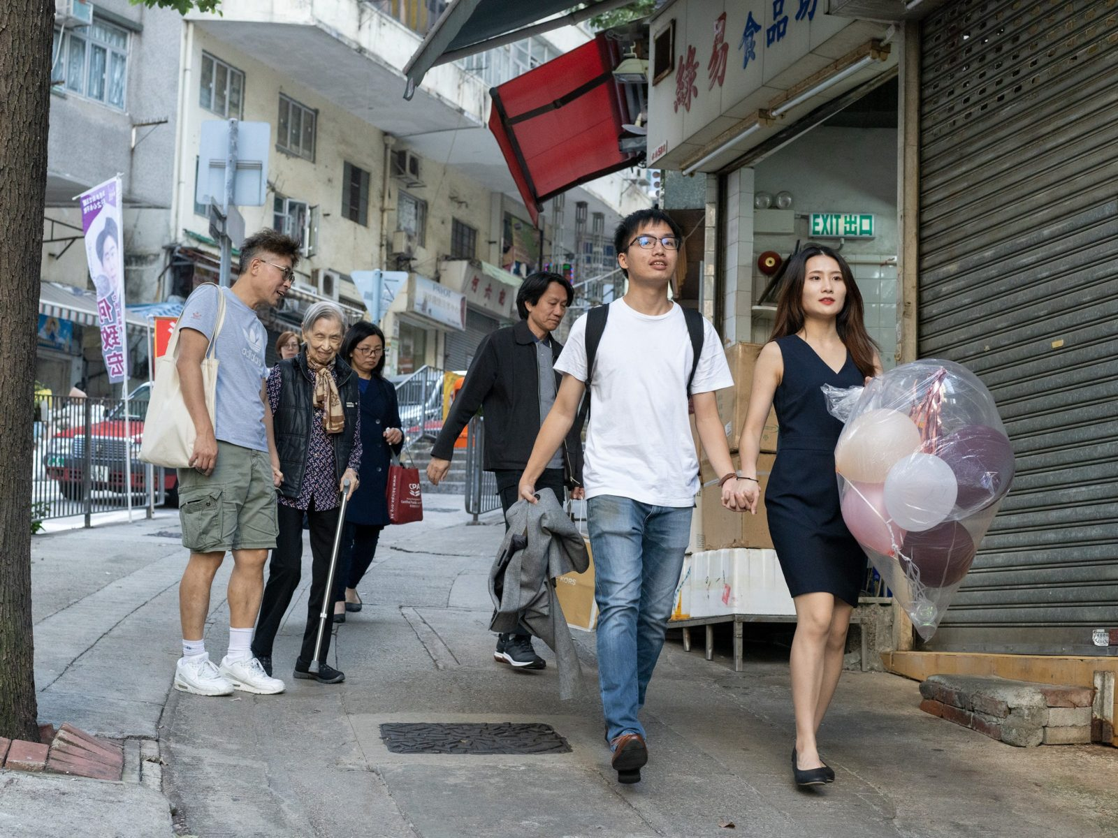 Colour photo of couple in street