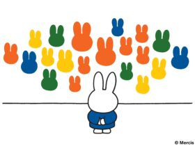 A drawing of a bunny looking at paintings of green, orange, yellow and blue bunny heads on a wall