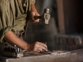 Blacksmith hammering a horseshoe