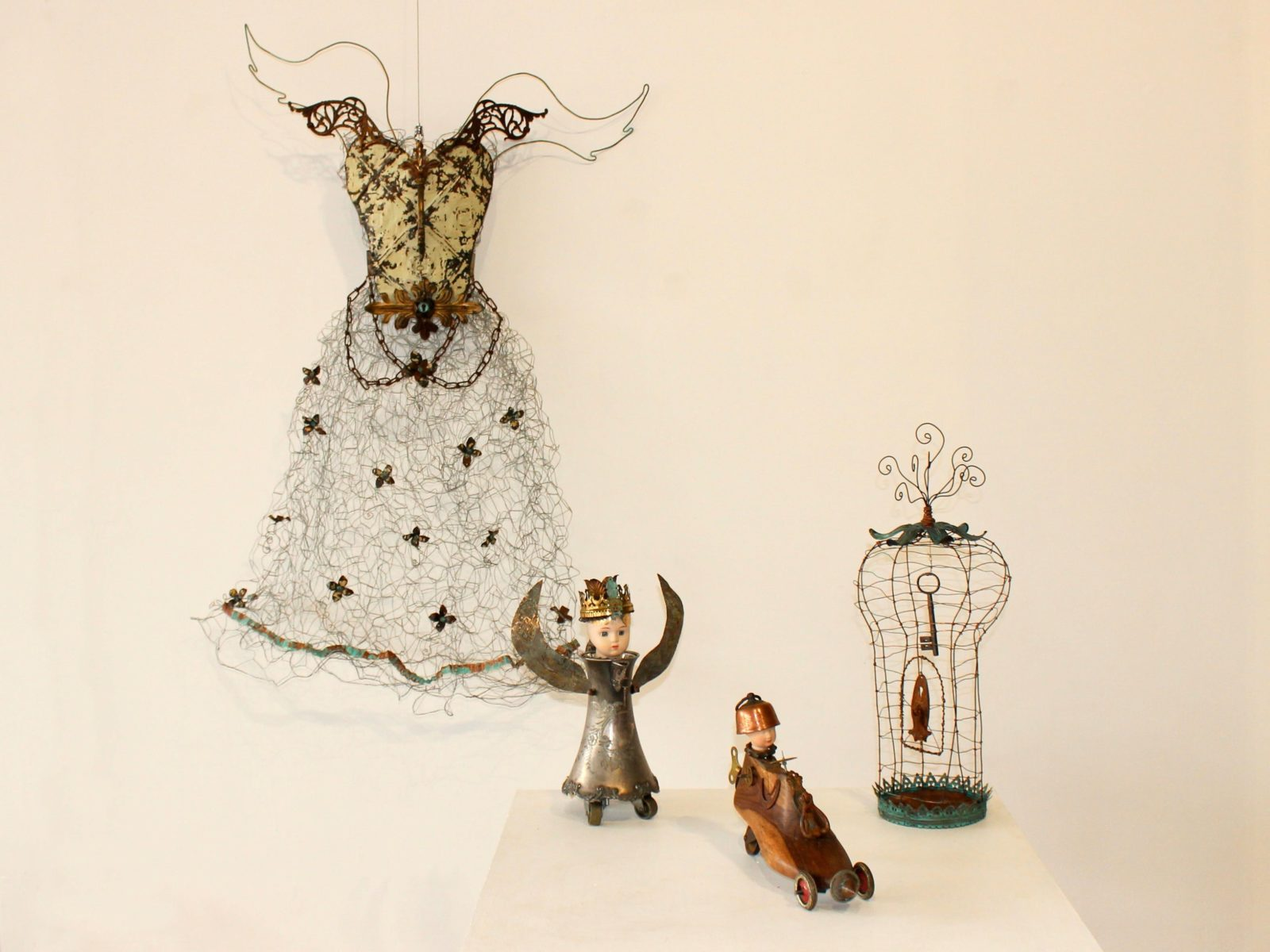 Pressed metal and wire angel, birdcage and fantasy creatures