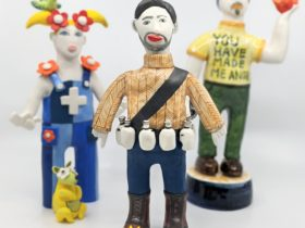 Three colourful ceramic figures