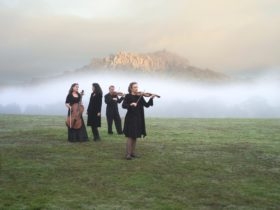 Musicians in front of Hanging Rock, near Woodend