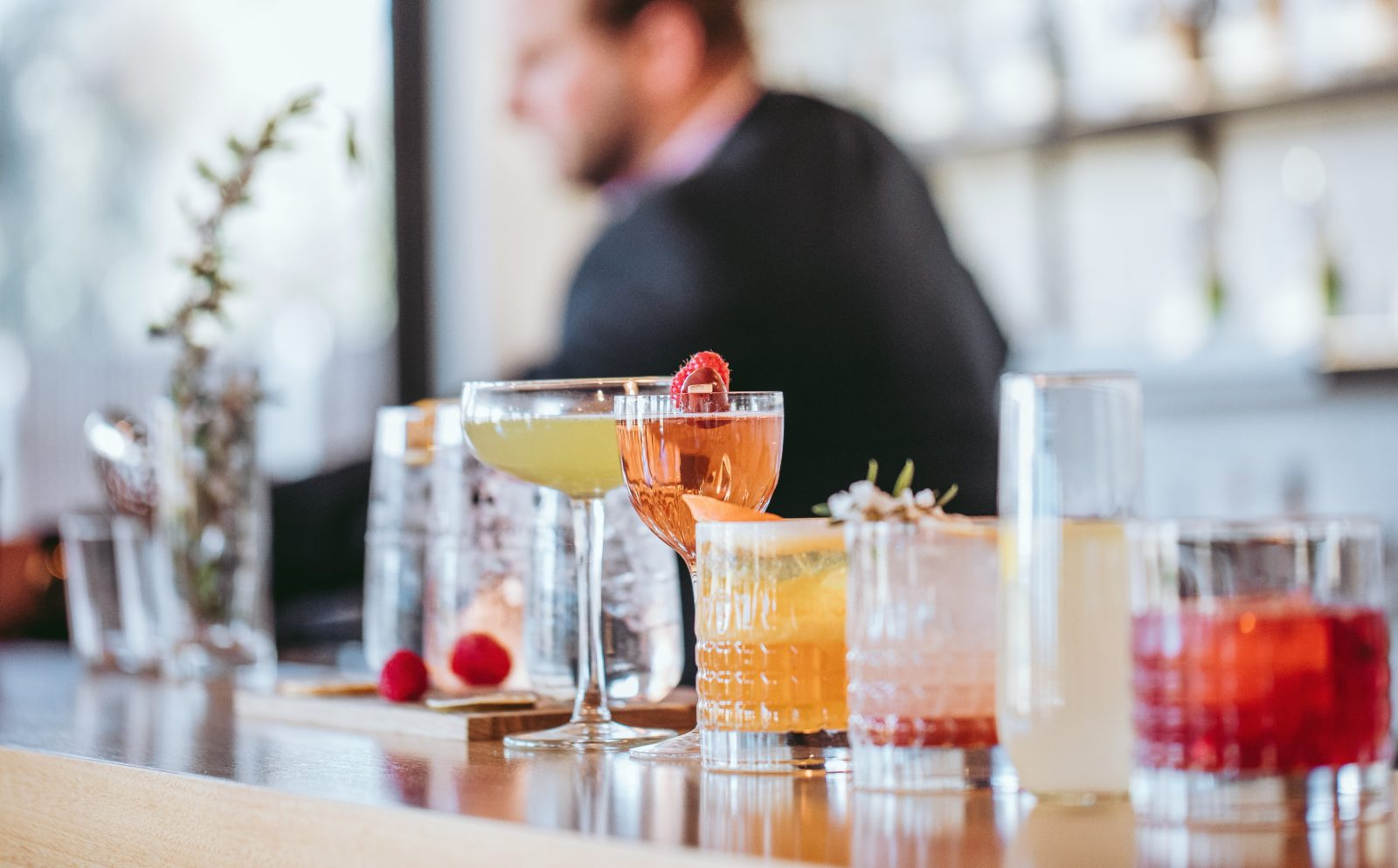 Cocktails lined up at the bar