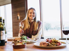girl enjoying a glass of wine and platters