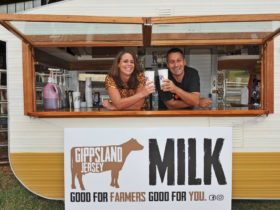 Gippsland Jersey owners Sallie and Steve in branded caravan selling milkshakes