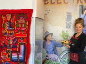 Cafe owner Giovanna with a dish traditional to Peru