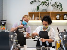 Retail staff pouring coffees