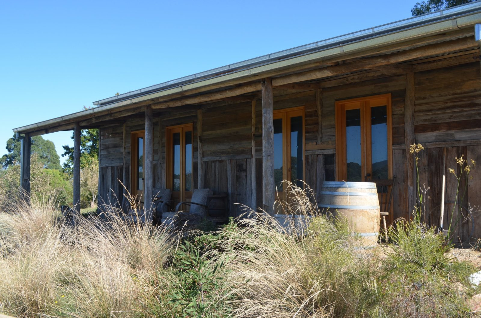 A view of the front of the Traviarti Winery with a barrel under the verandah.